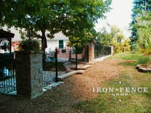 4ft Tall Wrought Iron Hoop and Picket style fence stepped for yard grade