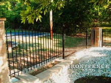 4ft tall iron hoop and picket fence stepped down a knee wall