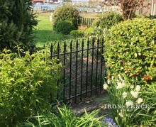Wrought Iron Fence Panels used in a Garden Setting (3ft Tall Classic Style)