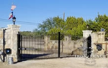 Iron Driveway Estate Gate with Stone Columns and Linear PRO Automation