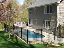 Our 4ft Tall Classic Iron Fence Installed on a Stone Wall Surrounding a Pool