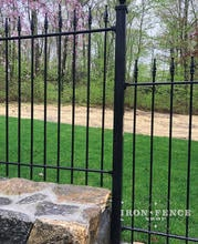 A Closer View of our 4ft Iron Fence Stepped Down a Stone Wall Base